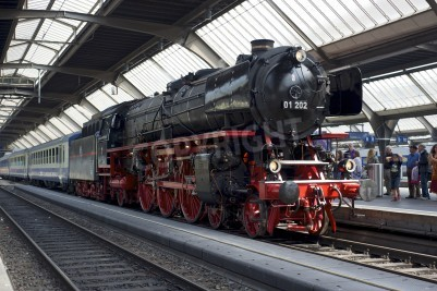 Poster Zurich, Switzerland - June 4, 2011: A train with a refurbished Pacific 01 202 steam locomotive is ready to depart from Zurich main station (Hauptbahnhof).