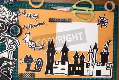 Sticker a horizontal overhead view of a Halloween scapbook layout