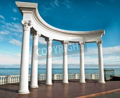 Sticker Ancient Greek columns against a blue sky and sea