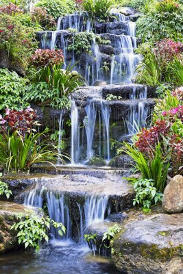 Sticker Artificial waterfall and statue at the garden