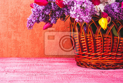 Basket with lilac and tulips