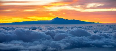 Sticker Beautiful cloudscape with Tenerife island on background on the sunrise in Spain