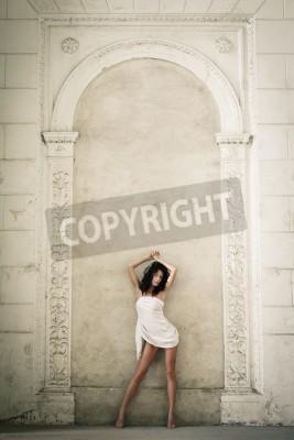 Sticker Beautiful sexy woman posing in a castle interior