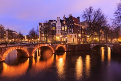 Sticker Beautiful view of Amsterdam canals with bridge and typical dutch