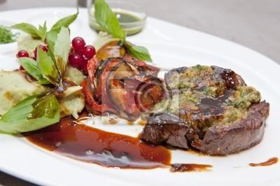 Beef steak cooked in wine sauce