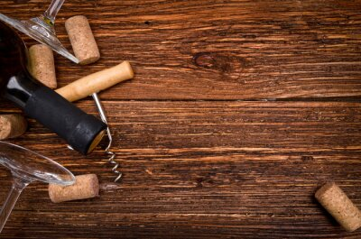Sticker Bottle of  wine, corkscrew and corks on wooden table. Background