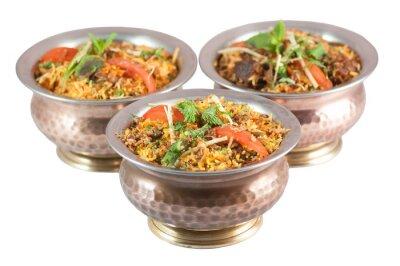 Sticker chicken biryani or vegetarian biryani or indian risotto in tin bowls