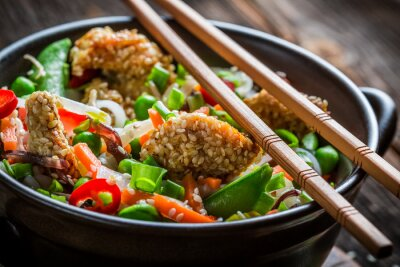 Sticker Chicken with sesame with vegetables and noodles