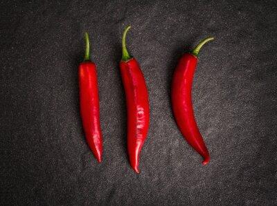 Sticker chili pepper on black stone background