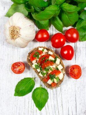 Sticker Ciabatta bread with tomatoes, mozzarella and basil.