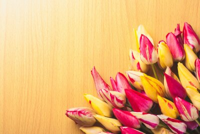 Colorful tulips on wooden background_4