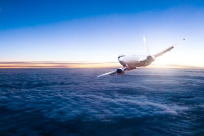 Sticker Commercial jet aeroplane flying above clouds