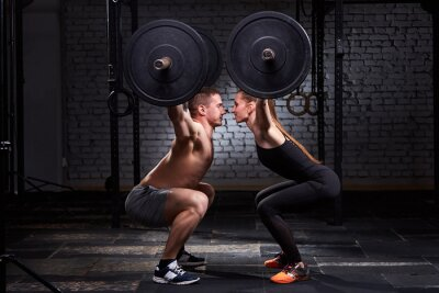 Sticker Crossfit lifting bar by woman and man in group workout against brick wall.