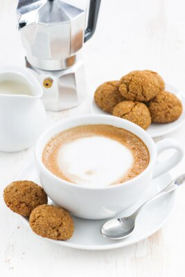 Sticker cup of cappuccino and macaroons on white wooden table