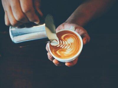 Sticker cup of coffee latte art in coffee shop