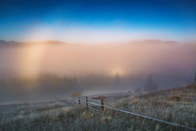 Deep morning fog in alpine valley