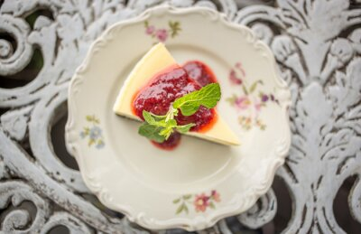 Sticker Dessert - Cheesecake with Berries Sauce and Green Mint, top view