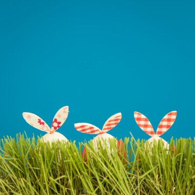 Sticker Easter eggs on green grass