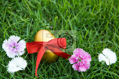 Sticker Easter eggs on green grass with flower