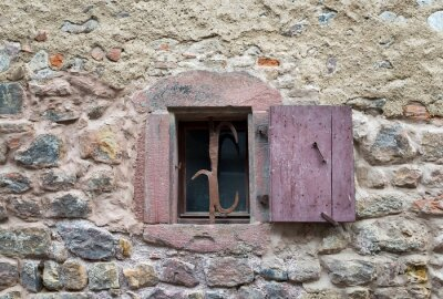 Sticker French window with closed old medieval wooden shutters in the