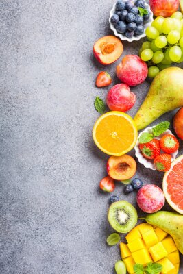 Sticker Fresh assorted fruits and berries on light gray background. Colorful clean and healthy eating. Detox food. Copy space. Top view.