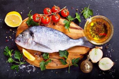 Sticker fresh fish dorado with vegetables