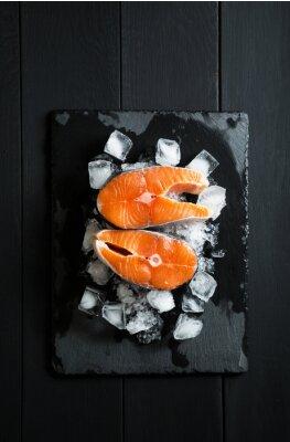 Sticker Fresh pieces of salmon on ice