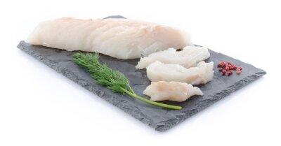 Sticker Fresh raw cod fillet on a slate plate