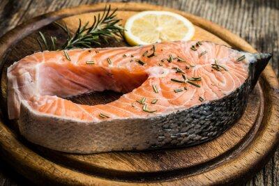 Sticker fresh raw salmon on wooden cutting board