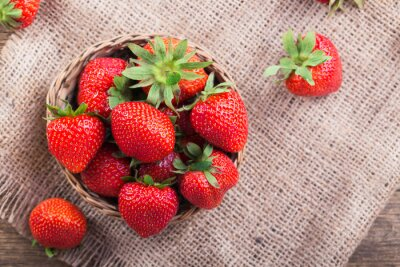 Sticker Fresh red strawberries on old wooden background