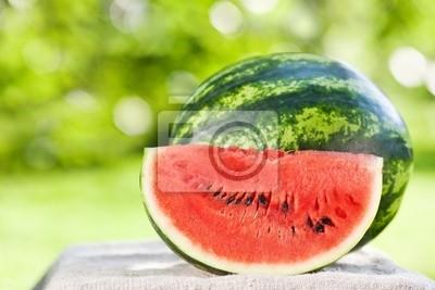 Sticker Fresh watermelon against natural background