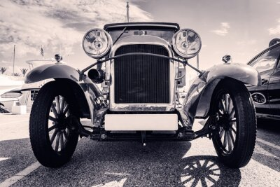 Sticker Front view of classic car. Old style. Black and white.