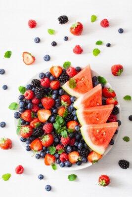 Sticker fruit and berry platter over white. blueberry, strawberry, raspberry, blackberry, watermelon