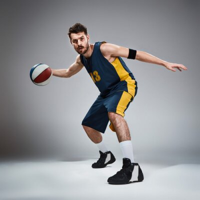 Sticker Full length portrait of a basketball player with ball