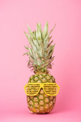Sticker funny and tasty pineapple in sunglasses on pink background