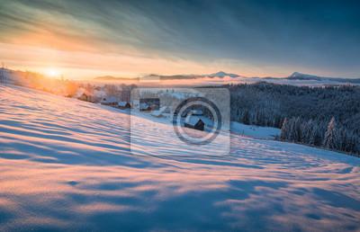 Golden sunrise above the carpathian mountain village