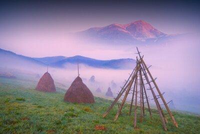 haystacks in a misty valley_1