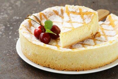 Sticker homemade cheesecake with powdered sugar and cherry