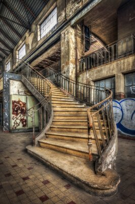 Sticker Imposing staircase inside the hall of an abandoned power plant