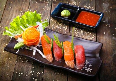 Sticker Japanese Salmon, tuna sushi and sauce closeup