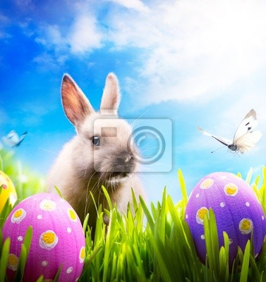 Sticker Little Easter bunny and Easter eggs on green grass