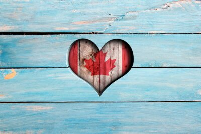 Sticker Love Canada. Heart and flag on a blue wooden board