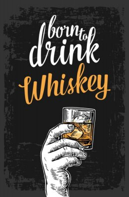 Sticker Male hand holding a glass with whiskey and ice cubes. Vintage vector engraving illustration for label, poster, invitation to a party