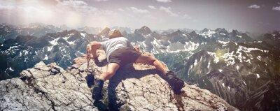 Sticker Man Scrambling Over Rocks on Mountain Ledge