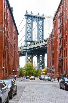 Sticker Manhattan Bridge seen between buildings in New York City