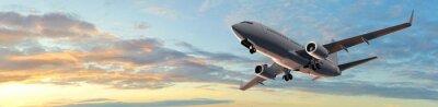Sticker Modern Passenger airplane flight in sunset panorama
