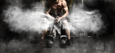 Sticker Muscular man workout with kettlebell at gym