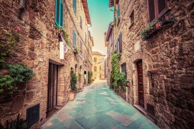 Sticker Narrow street in an old Italian town of Pienza. Tuscany, Italy. Vintage