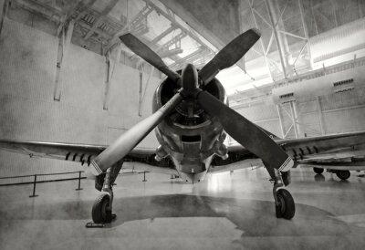 Sticker Old airplane in a hangar