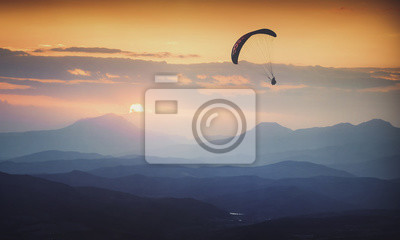 Over the foggy valley sunrise. Instagram stylization